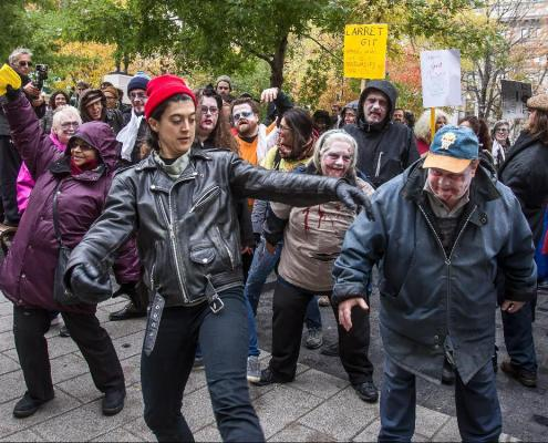 MONTREAL, QUE.: OCTOBER 23, 2014 -- Project Genesis organized a zombie march at Dorchester Square in Montreal, on Thursday, October 23, 2014 to bring attention to the slow pace of hearings at the Regie du Logement. (Dave Sidaway / THE GAZETTE)